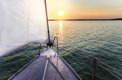 Sailing to the sunset Stock Photography