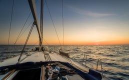 Sailing to sunset Royalty Free Stock Photos