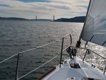 Sailing toward the Golden Gate Bridge. Sailboat sailing on San Francisco Bay toward the famous Golden Gate Bridge Stock Photos