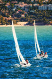 Sailing towards Cap Martin. Sailboats are navigating in the direction of Cap Martin in Roquebrune France during a Regatta Royalty Free Stock Image