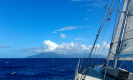 Sailing towards Dominica. Approaching Dominica under sail in perfect conditions royalty free stock image