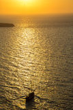 Sailing towards hazy sunset, Santorini, Greece Royalty Free Stock Photography