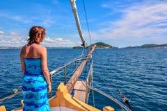 Sailing towards the island Stock Photos