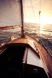 Sailing towards the sun Royalty Free Stock Images