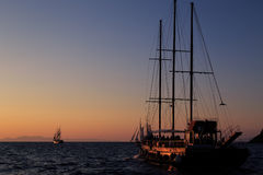 Sailing towards the sunset in Santorini. royalty free stock photography