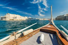 Sailing on traditional wooden boat in Malta.  Royalty Free Stock Images