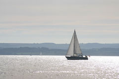 Sailing on tranquil waters Royalty Free Stock Photography