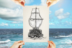 Sailing and travel concept. Four male hands holding paper sheet with creative pencil drawing of ship on blue sky and sea background. Sailing and travel concept Royalty Free Stock Photos