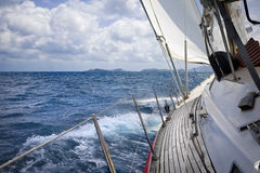 Sailing through the tropics. View from onboard luxury sailboat sailing through the tropics Stock Photo
