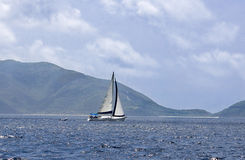 Sailing in the tropics. Luxury sailboat sailing through the waters of the British Virgin Islands Royalty Free Stock Photo