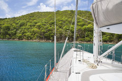 Sailing in the tropics. View from luxurious sailboat of beautiful tropical island Stock Photography
