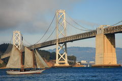 Sailing under the Bay Bridge Royalty Free Stock Image