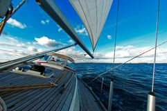 Sailing under blue sky Royalty Free Stock Photography