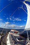Sailing under blue sky. Sailing yacht under the blue sky with clouds Royalty Free Stock Photos