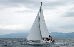 Sailing under clouds Stock Photos