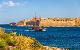 Sailing vassel passing Marsamxett Harbour. In Malta Stock Photography