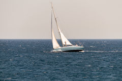 Sailing Vessel in Deep Blue Ocean Stock Image