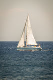 Sailing Vessel in Deep Blue Ocean Royalty Free Stock Photo
