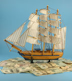 Sailing vessel and dollars Stock Photos