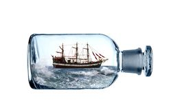 Sailing vessel in glass bottle stock photography