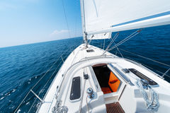Sailing vessel moves in an open sea Stock Photography