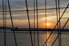 Sailing vessel ropes against sunset Royalty Free Stock Photo