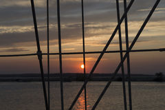 Sailing vessel ropes against sunset Stock Images