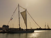 Sailing vessel at the sea. The beautiful sailing vessel in the quiet sea Stock Photography