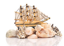Sailing vessel and sea shells Stock Photography