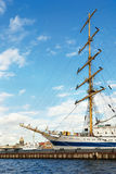 Sailing vessel in St-Petersburg port. Old sailing vessel in St-Petersburg port with modern yacht and St' Isaac cathedral on the background stock image