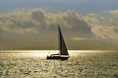 Sailing vessel in the sunset Royalty Free Stock Photos