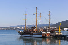 Sailing vessels Corsair and Gloria at the pier in Gelendzhik Bay early in the morning, Krasnodar region, Russia Royalty Free Stock Photos