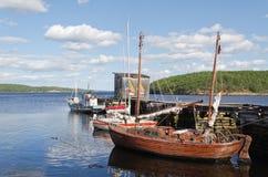 Sailing vessels at a mooring. Sailing vessels at yacht club Chupa mooring by the White sea (Russia royalty free stock photos