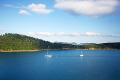 Sailing in the Whitsundays. Sailing boats on calm waters near Whitehaven Beach in Whitsundays, Australia Stock Photography