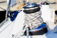 Sailing winch with halyard rope Royalty Free Stock Images
