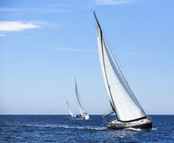 Sailing in the wind through the waves at the Aegean Sea in Greece. Luxury yachts royalty free stock photography