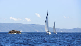 Sailing in the wind through the waves at the Aegean Sea in Greece. Royalty Free Stock Image