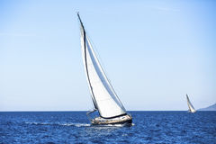 Sailing in the wind through the waves at the Aegean Sea in Greece. Stock Images