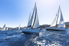 Sailing in the wind through the waves at the Aegean Sea in Greece. Royalty Free Stock Photography