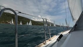 Sailing in the wind through the waves at the Aegean Sea in Greece. Sailing regatta. stock video footage