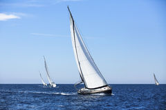 Sailing in the wind through the waves at the Aegean Sea in Greece. Stock Photo
