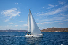 Sailing in the wind through the waves at the Aegean Sea. Luxury yacht at regatta. Sailing in the wind through the waves at the Aegean Sea royalty free stock photo