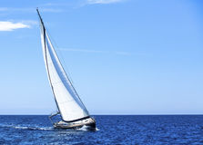 Sailing in the wind through the waves at the Aegean Sea. Royalty Free Stock Photography