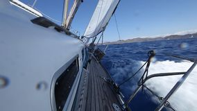 Sailing in the wind through the waves stock video footage