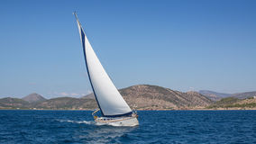 Sailing in the wind through waves. Stock Image