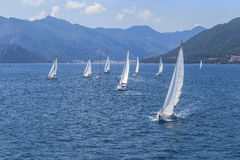 Sailing in the wind through the waves at the Mediterranean Sea. Royalty Free Stock Photo