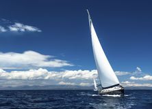 Sailing in the wind through the waves. Romantic. Stock Image