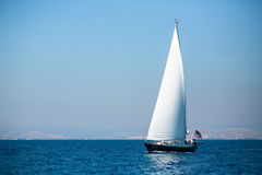 Sailing in the wind through the waves at the Sea. Royalty Free Stock Photos