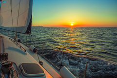 Sailing in the wind through the waves during sunset at the Aegean Sea in Greece. Royalty Free Stock Photos