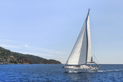 Sailing in the wind through the waves. Stock Images